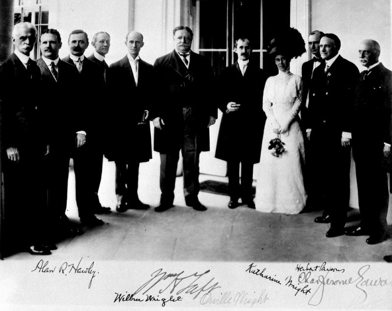 A portrait of President Taft and the Wrights, including Katharine on the White House portico after he presented them with medals from the Aero Club of America.