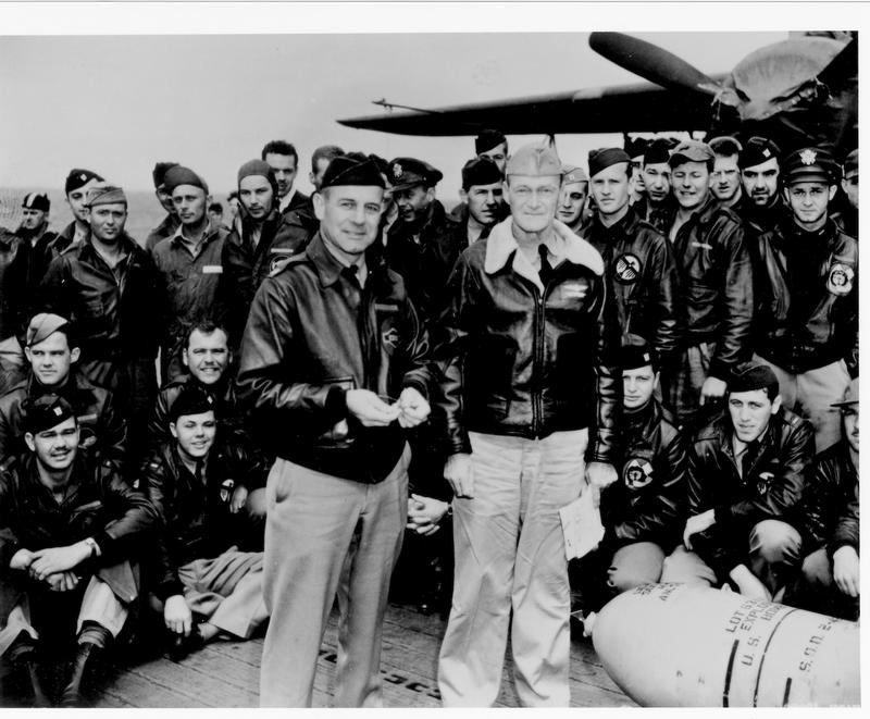 Col. Doolittle  (left) and Admiral Marc Mitscher (right) surrounded by the volunteers, over Admiral Mitscher's left shoulder, Tom Griffin.
