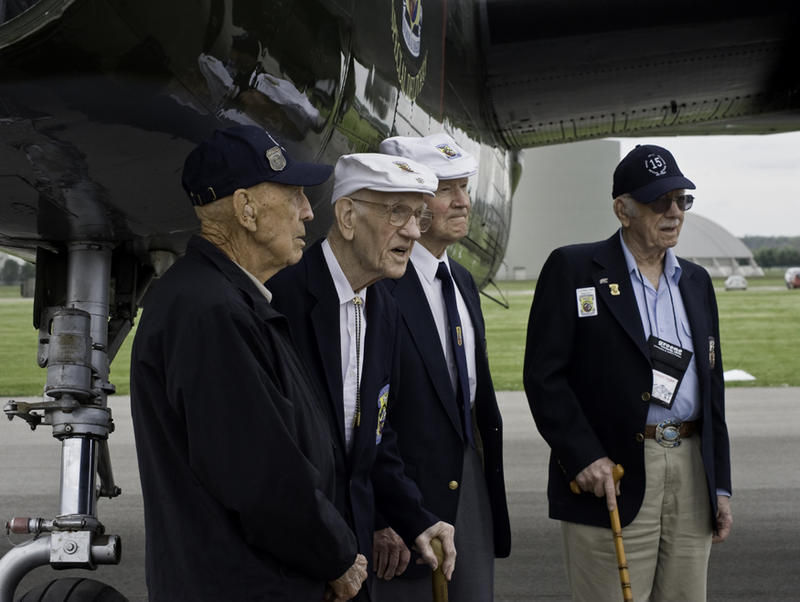 Four of the Raiders in 2012 under the nose of a B-25, Tom Griffin second from left, at the National Museum of the United States Air ForceF