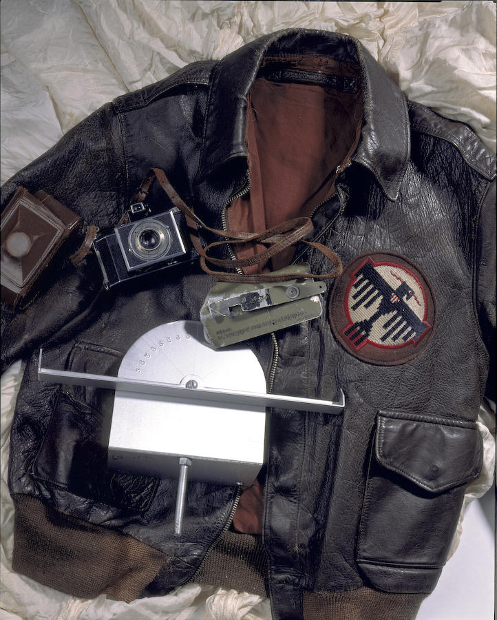 A selection of artifacts from the raid, the flight jacket worn by Tom Griffin and in the crew photo with Admiral Mitscher and Jimmy Doolittle.