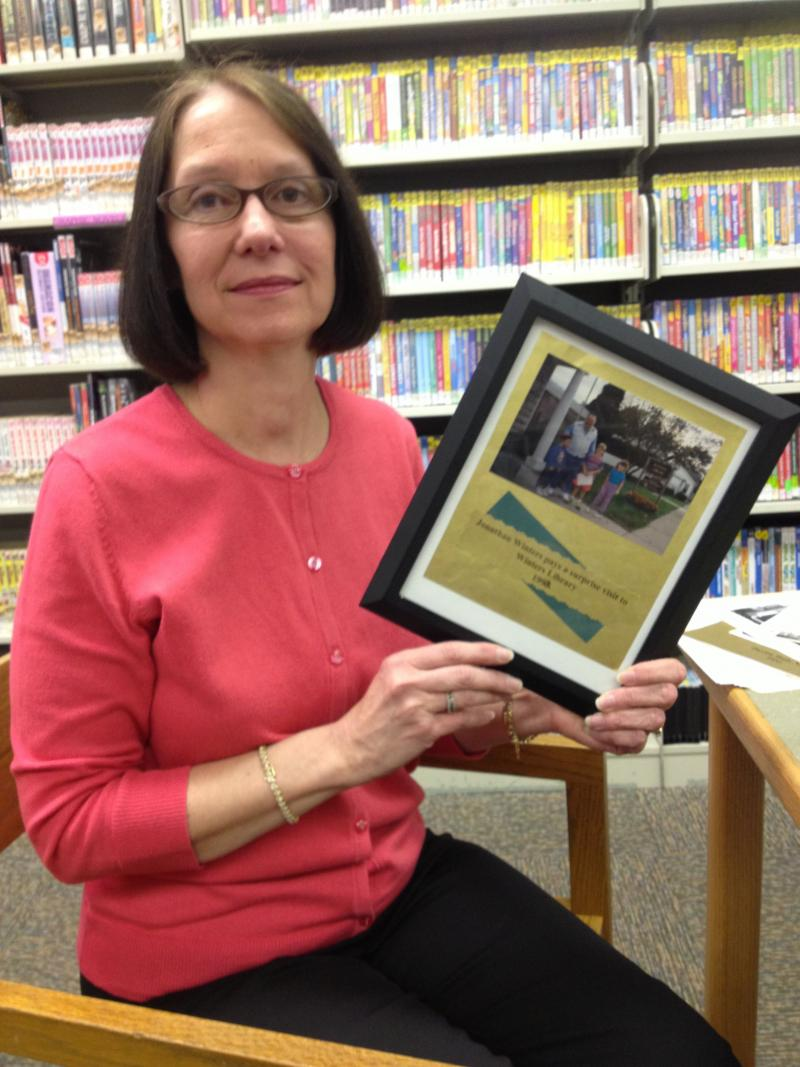 Jo Ellen Fannin holding a picture taken during Winters' last visit to the library in 1992