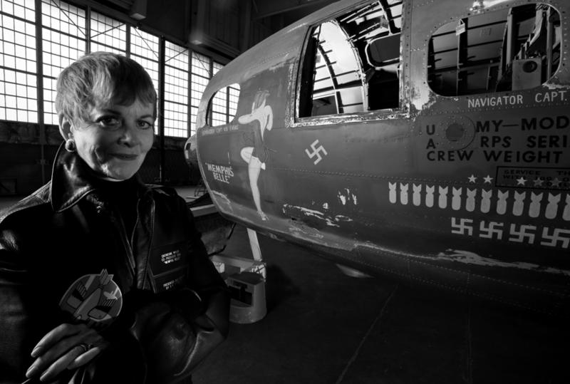"Film Producer Catherine Wyler (daughter of William Wyler who made WWII documentary) who made the 1990 film ""Memphis Belle"" standing alongside the original painted nose art of the Memphis Belle, painted in 1943 by Sgt. Tony Starcer, 91st Bomb Group."