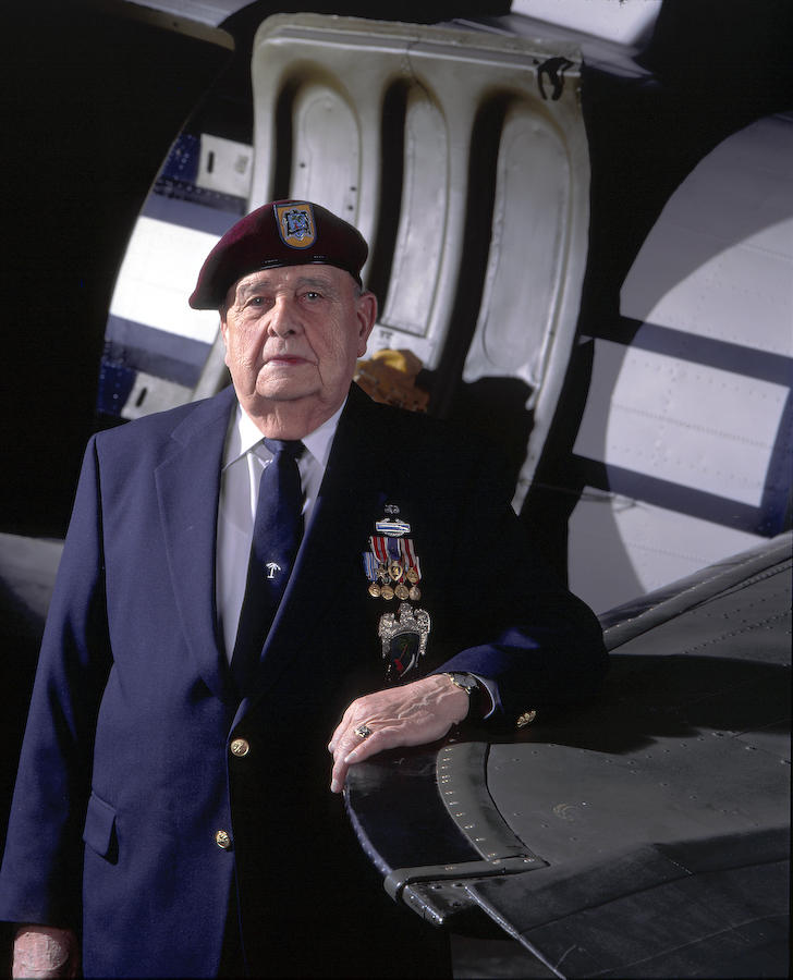 Portrait of Jack Reames in front of C-47 door