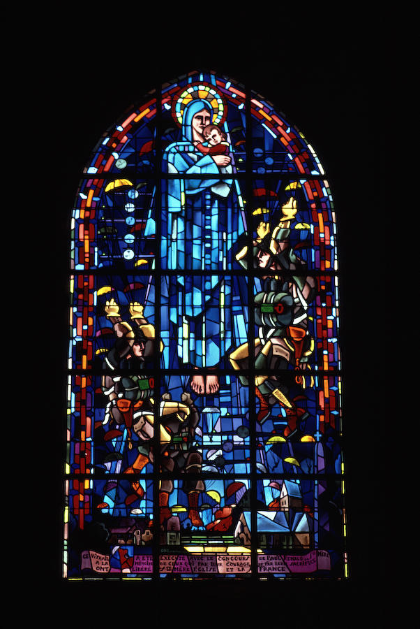 Memorial window to the airborne assault inside the church at St. Mer Eglise
