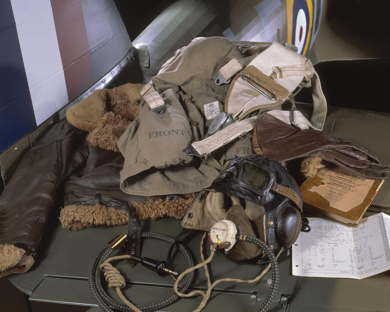 "On the tailplane of a Hawker Hurricane the flight kit of a Battle of Britain pilot would have included the sheepskin lined ""Irvin"" jacket."