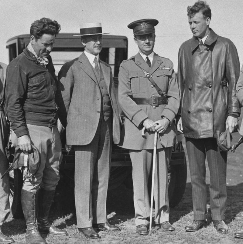 Orville Wright welcomes Charles Lindbergh to Wright Field, Lindbergh wearing the leather jacket, an un-named flier is wearing a cloth flight jacket.