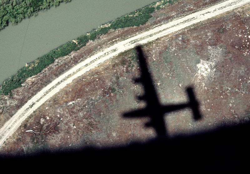 The shadow of a B-24 Liberator in flight.  These bombers were used by the U.S. Army Air Force in WWII