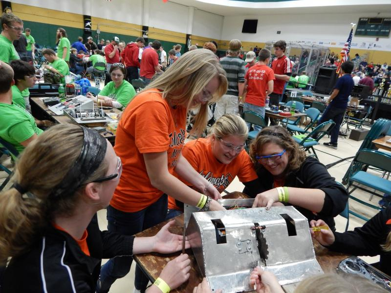 The team from Coldwater, Ohio, repairs their weaponized 'bot.