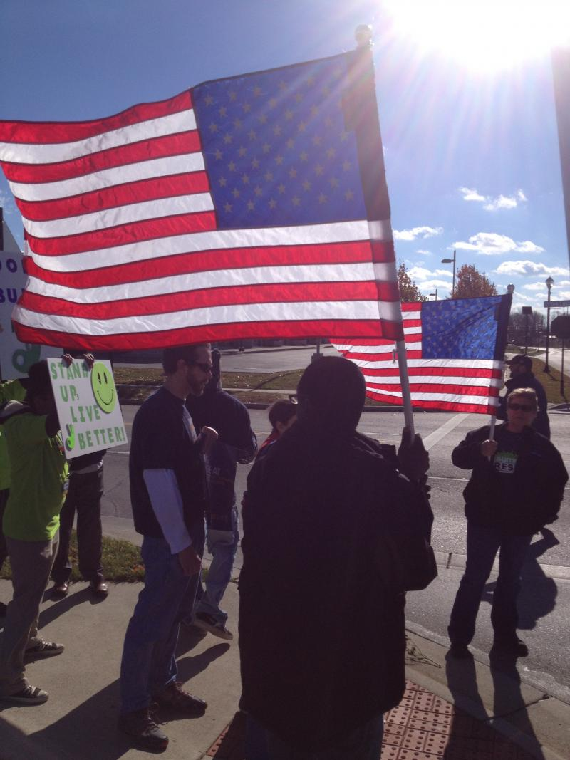 "Workers march to deliver ""strike papers"" to Walmart officials. Nov 2013"