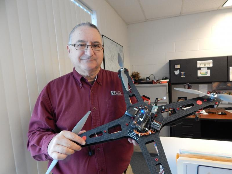 Frank Beafore with one of the drone models designed at SelectTech Geospatial in Springfield.