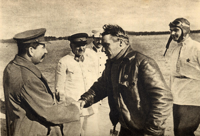 Stalin shaking hand with aviator Valery Chkalov in 1936