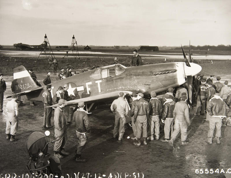 This photo dated December 27, 1943 illustrates the introduction of the P-51 to the crews.