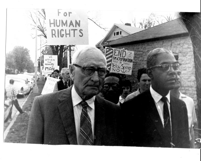 In September of 1963, Walter Anderson, Antioch College's first black faculty member, lead hundreds of villagers on a March through Yellow Springs to mourn four little girls killed in a Birmingham church bombing, and to strengthen the movement's solve