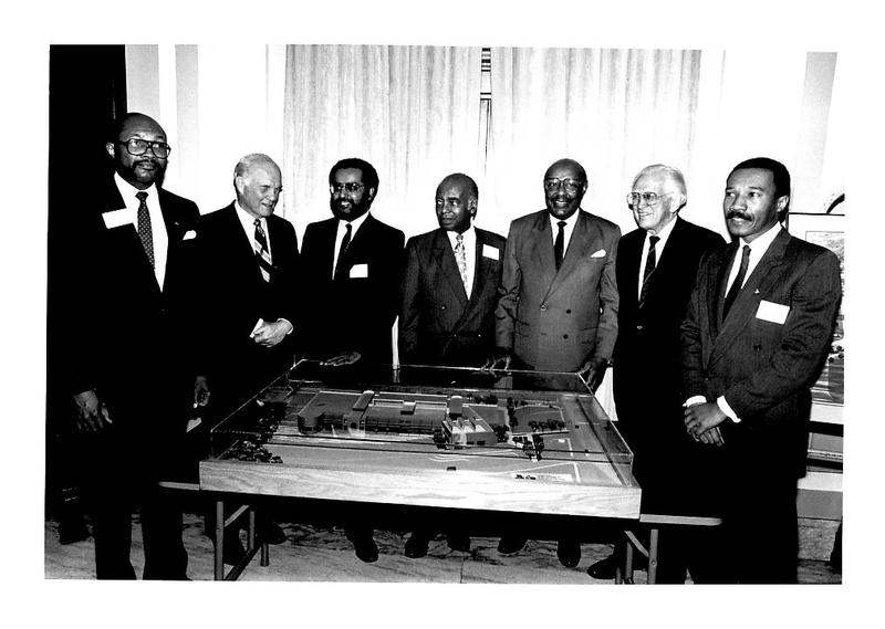 Ohio and Congressional Black Caucus Officials with founding director Dr. John E. Fleming admire the architectural model of the National Afro-American Museum & Cultural Center in the 1980s.