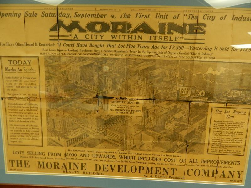 A photo of a 1927 advertisement for the city of Moraine posted in city hall; in addition to being an early industrial site in Dayton, David Hicks says it was considered a riverside getaway for Dayton residents.