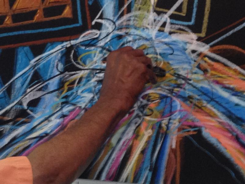 The artist's hand dances across the paper.