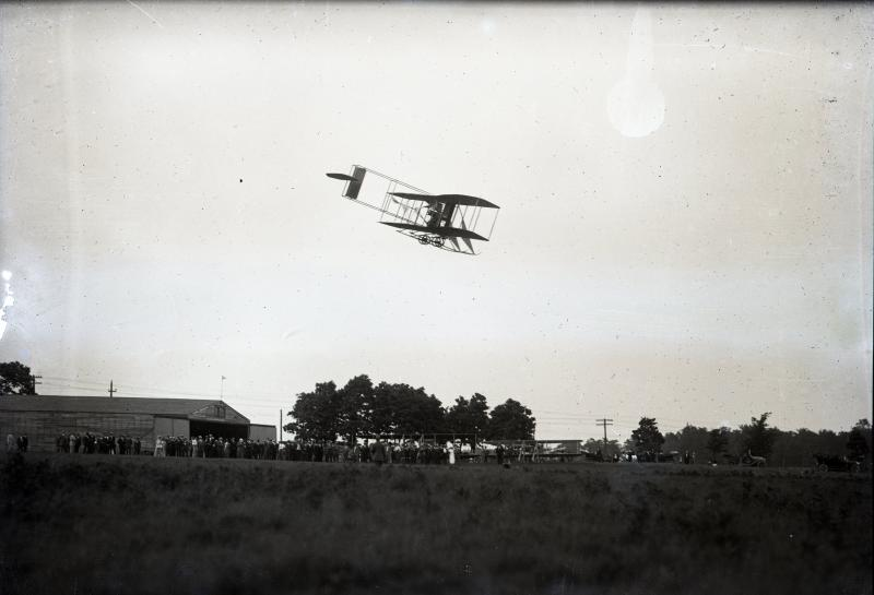 A Wright airplane flying at Huffman Prairie, ca. 1910