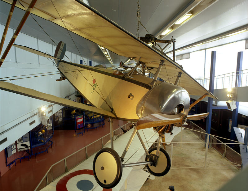"The very small and fragile early ""pursuit"" airplane a Nieuport 17 on exhibit at the Musee de'l'air et Space in Paris."