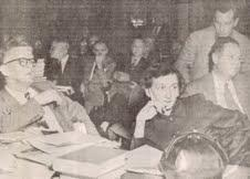 News clipping of Anne and Carl Braden, sedition trial, 1954. The piles of their books and an FBI informant were the basis of the state's case against the Bradens.