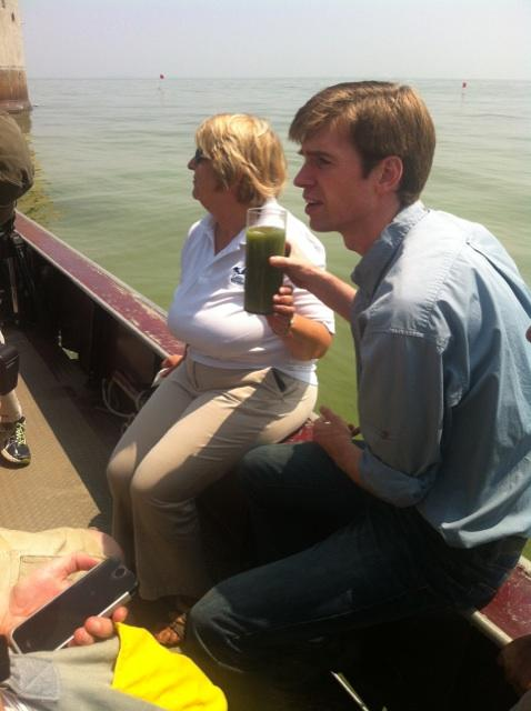 Collin O'Mara, President of the National Wildlife Federation, held up a glass of algae-filled water from Lake Erie after the toxins produced by the algae shut down Toledo's water system.