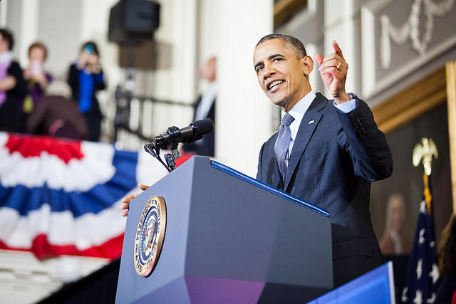 President Barack Obama speaks about affordable health care at an event in 2013 with Massachusetts Governor Deval Patrick. Despite controversy and a bumpy rollout, the president's signature bill enrolled more people than it had originally aimed for.