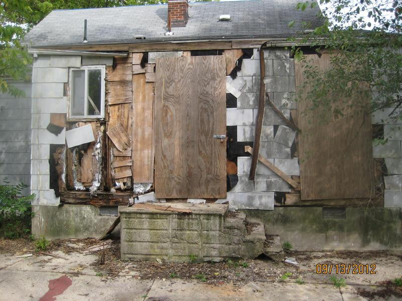 An under-maintained home in a black neighborhood.