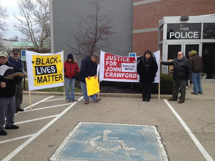 Protestors demonstrate in front of Beavercreek Police station following the death of John Crawford III inside a Beavercreek Walmart in 2014.