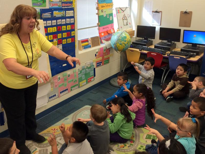 Kindergarten teacher Elly Mallen leads her class through a lesson on saying numbers and months in Spanish.