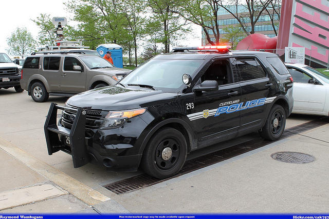 A Cleveland police vehicle. An officer is accused in the shooting death of two unarmed people in 2012.