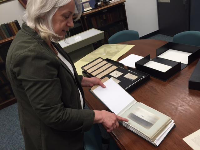 Dawne Dewey, head of Special Collections at Wright State, pours over items in the largest known collection of Wright Brothers artifacts artifacts.