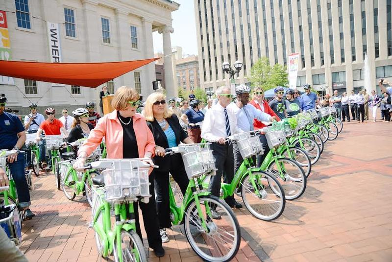 After cutting the ribbon on Dayton's new 'Link' bike-share program, city officials get ready to ride.