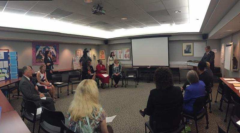 State officials announce the rollout of the Centering Pregnancy program offering women a support network of prenatal care.