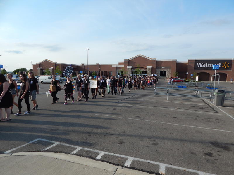More than 200 protesters gathered in front of the locked Walmart Wednesday. crawford