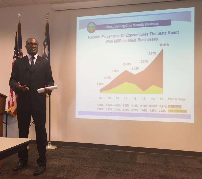 Kenyatta Chandler with Ohio Development Service talks with minority  business owners st the Dayton Job Center.