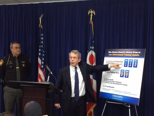 Ohio Attorney General Mike DeWine presenting proposed training standards for police officers.