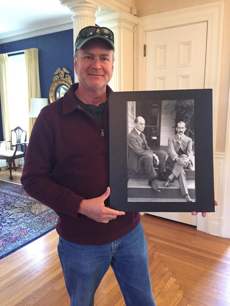Steve Wright holds a picture of his famous ancestors, Orville and Wilbur Wright.