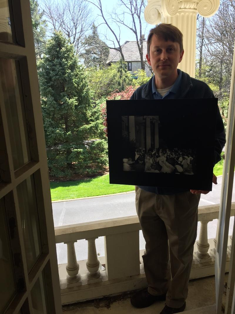 Alex Heckman with Dayton History stands on the balcony just off Orville Wright's bedroom.