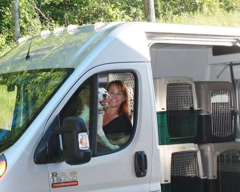Donna Ruff, Founder and CEO of Ruff Transport, with her beloved Zoey and the Ruff dedicated animal rescue transport van.