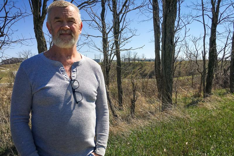 Carroll County resident Barry Booth stands near his home, which is within sight of a natural gas compressor station. He believes emissions from the facility have contributed to his family's health problems.