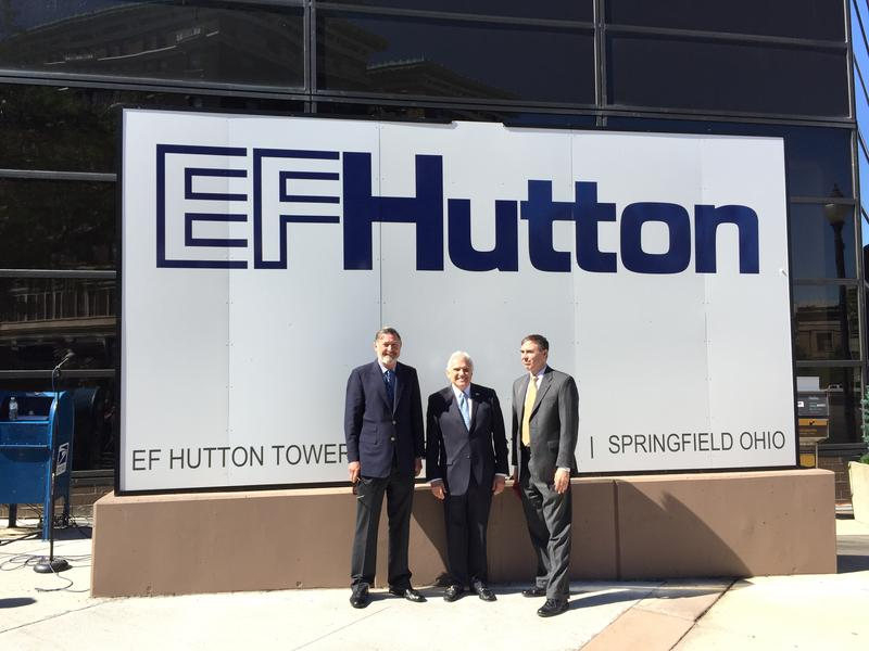 Two EF Hutton directors, and one former director, stand in front of the company's new headquarters in downtown Springfield in 2016.
