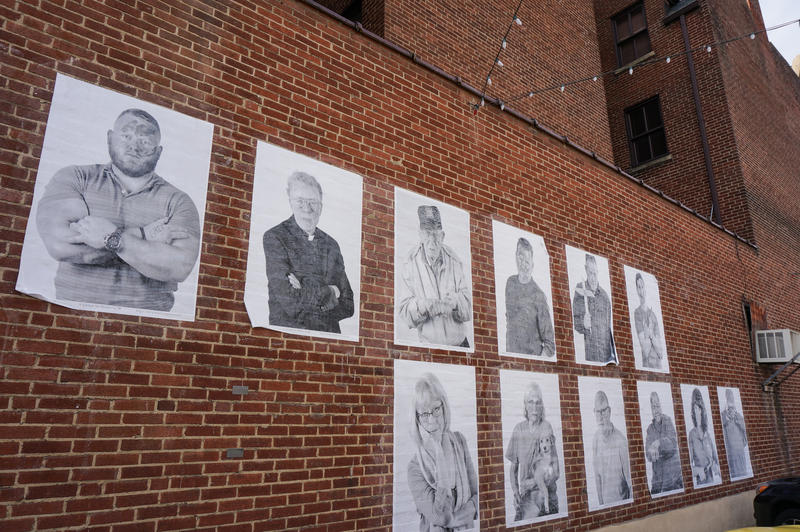 These are just a few of the large portraits that have been pasted on walls across Wilmington.