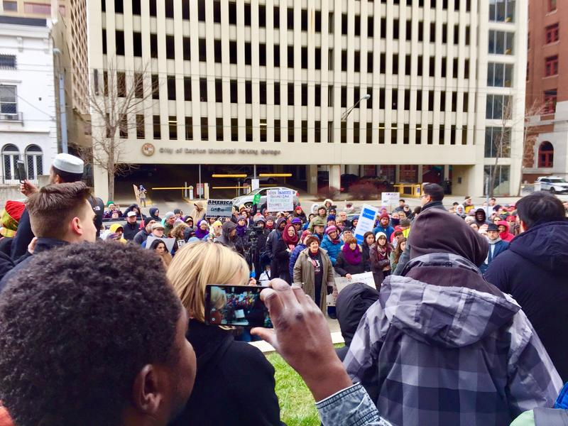 Hundreds rallied in Dayton to protest President Donald Trump's executive order, which includes a 90-day ban on travel to the U.S. by citizens of Iraq, Syria, Iran, Sudan, Libya, Somalia and Yemen, and a 120-day suspension of the U.S. refugee program.