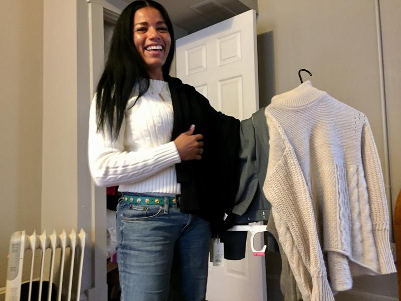 Tyra Patterson prepares an outfit for her first day at her new job as a paralegal. After spending more than half her life in prison, Patterson is still figuring out how to wear