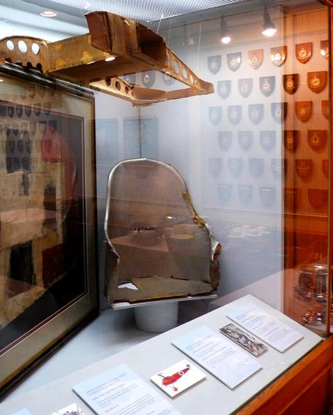 The seat, a wing section and fabric from the Fokker Dr. 1 in which Von Richtofen was shot down and killed.
