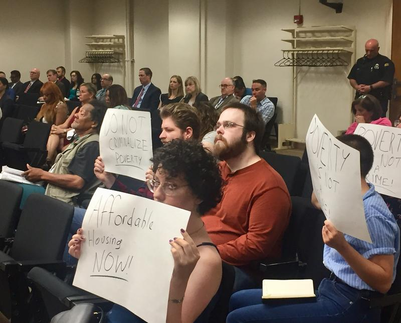 Activists protest Dayton's pedestrian safety ordinance at city commission meeting held May 23.