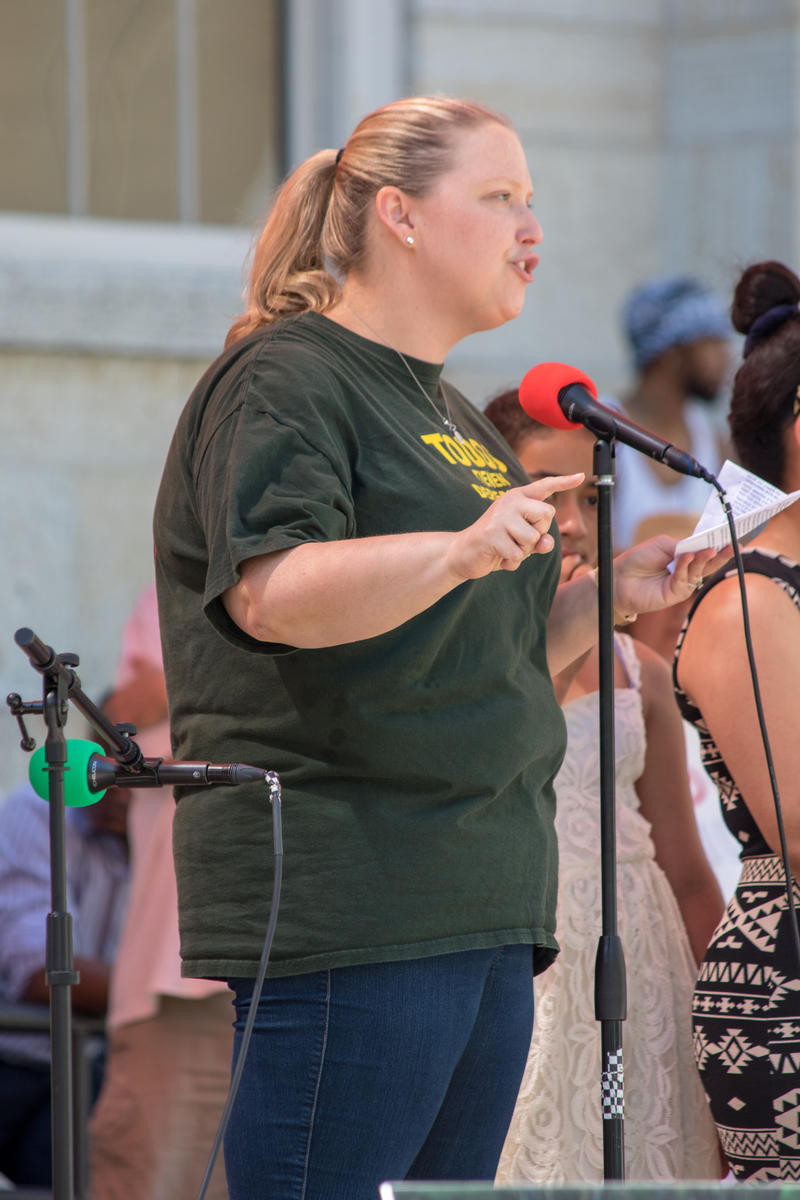 Advocates for Basic Legal Equality Attorney Jessica Ramos speaks at an immigration rally in downtown Dayton