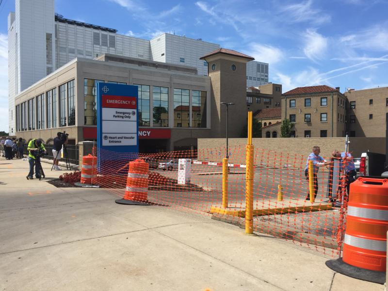 Shortly after noon on July 19, workers stretched construction barrels and webbing across the entrance to Good Samaritan Hospital's emergency center entrance.