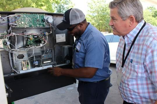 Auditor Keith and Inspector Joe Harris check a pump for skimmers