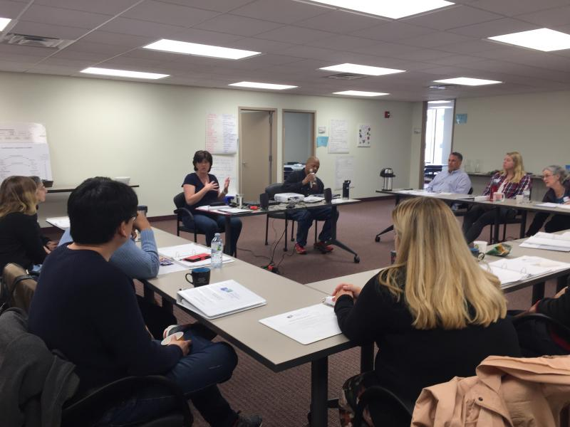 Trisha Werts (third from left) trains volunteers at The Dayton Mediation Center.