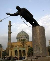 The statue of Saddam Hussein topples in Baghdad's Firdos Square on April 9, 2003.